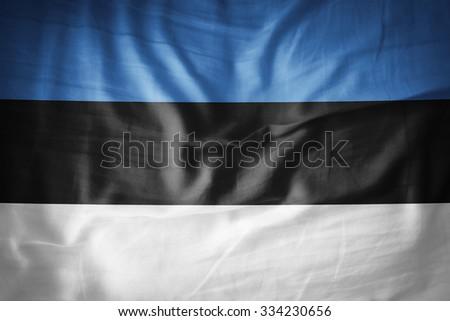 Estonia flag on grunge fabric - stock photo
