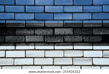 Estonia flag painted on old brick wall texture background