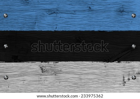Estonia national flag. Painting is colorful on wood of old train carriage. Fastened by screws or bolts. - stock photo