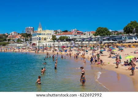 ESTORIL, PORTUGAL - JUNE 21, 2016: Public beach in Estoril in a beautiful summer day, Portugal on June 21, 2016