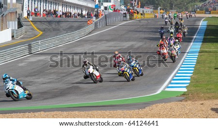 ESTORIL, PORTUGAL - OCTOBER 31 : lap 2 at curve 1 in Bwin MotoGP Portugal  2010 Race Moto2 October 31, 2010 in Estoril, Portugal - stock photo