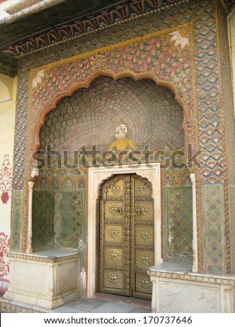 Etchings around a gold door in Jaipur, India - stock photo