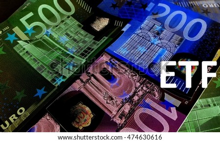 ETF -  The letters E, T, F against a dark background of euro bills.