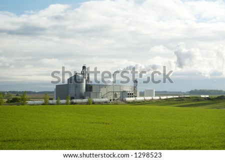 Ethanol production plant utilizing corn as a feed stock located in the middle of farm land in the Dakotas. - stock photo