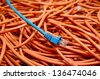 ethernet cables tangled blue and orange - stock photo