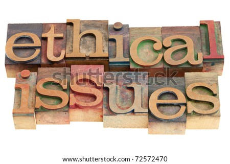 ethical issues words in vintage wood letterpress printing blocks, isolated on white