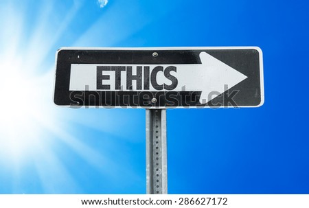 Ethics direction sign with a beautiful day  - stock photo