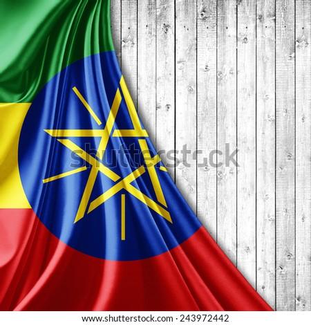 Ethiopia flag and wood background - stock photo