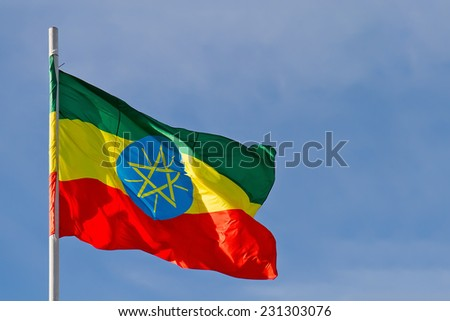 Ethiopia flag is waving in front of blue sky
