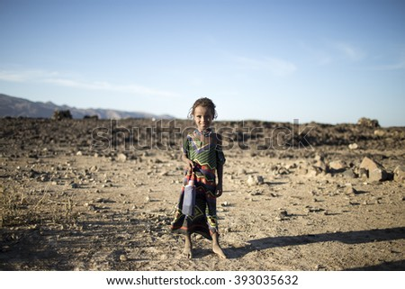Ethiopia, Jigjiga 2016 March: A girl from the south of Ethiopia.Water bottle in her hand. - stock photo