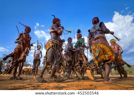 Ethiopia, Omo valley, 16.09.2013, Dancing Hamer tribe in a ceremony of initiation of young men  - stock photo