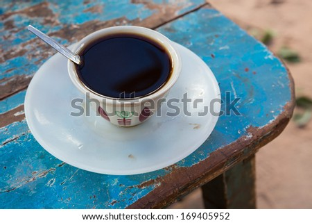 Ethiopian coffee in a cup from a street coffee seller - stock photo