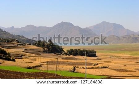Ethiopian landscape in the Korem region with Ashenge Lake, on the way to Lalibela - stock photo