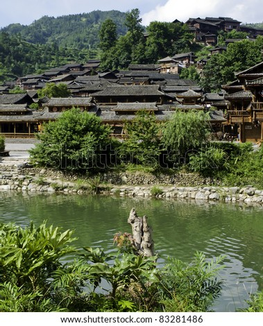 Ethnic Chinese Miao village near a river in rural China - stock photo