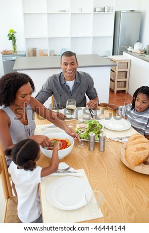 Ethnic family dining together in the kitchen - stock photo