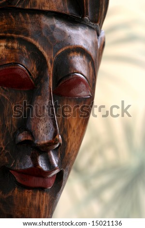 Ethnic hand carved wooden mask with copy space.
