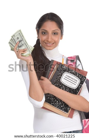 Ethnic Indian college student with compositions notebook, copybooks and backpack holds pile 100 (one hundred) dollar bills happy getting money help to subsidies costly university cost