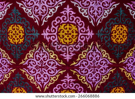 Ethnic oriental pattern on the cloth at Asian market    - stock photo