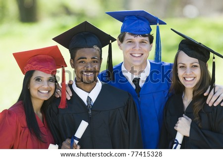 Ethnic students celebrating graduation in cap and gown.