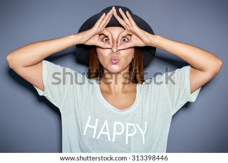 Ethnic woman making funny face with hands - stock photo