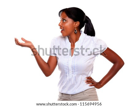 Ethnic young woman looking to her right with her hand up against white background - stock photo