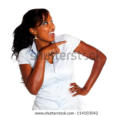 Ethnic young woman pointing and looking right against white background