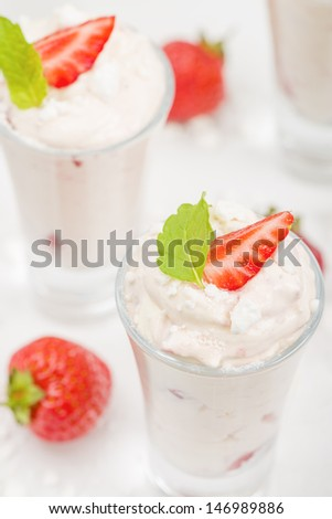 Eton Mess - Strawberries with whipped cream and meringue in shot glasses. Classic British summer dessert.