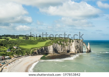 Etretat Aval cliff, rocks and natural arch landmark and blue ocean. Aerial view. Normandy, France, Europe. - stock photo