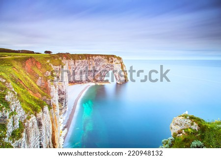 Etretat, la Manneporte natural rock arch wonder, cliff and beach. Long exposure photography. Normandy, France. - stock photo