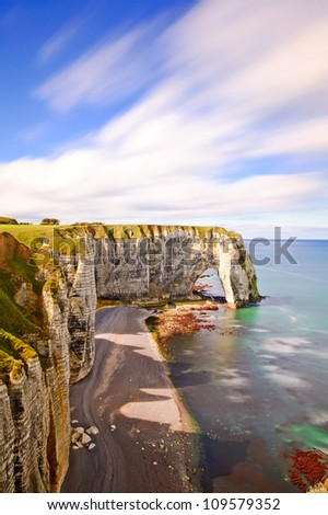 Etretat, the Manneporte natural rock arch wonder, cliff and beach. Long exposure photography. Normandy, France. - stock photo