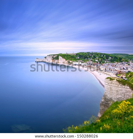 Etretat village and its bay beach, aerial view from cliff. Normandy, France, Europe. Long exposure photography - stock photo