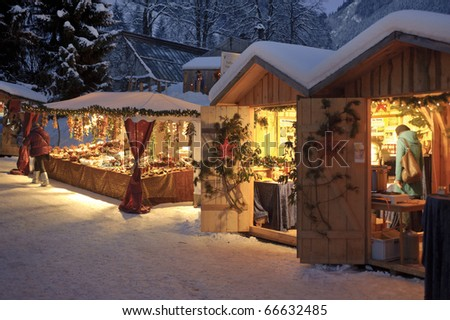 ETTAL, GERMANY - DECEMBER 4: Christmas market with illuminated shops for gift and decoration on December 4, 2010 in Ettal, upper bavaria, Germany - stock photo