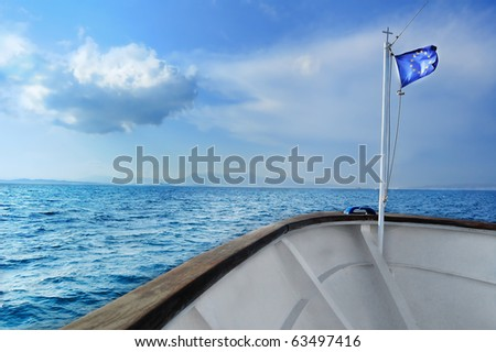EU Flag in front of a boat! - stock photo