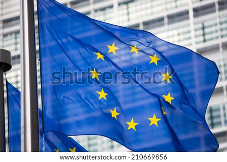 EU flag in front of Berlaymont building facade - stock photo