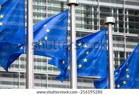 EU flags in front of Berlaymont building - stock photo