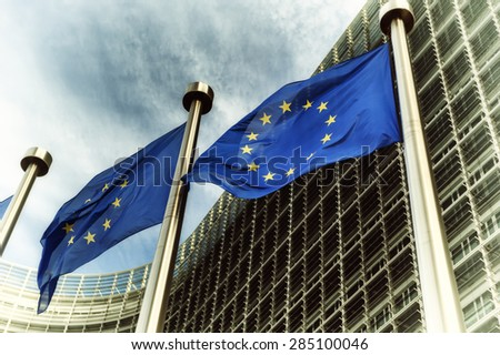 EU flags in front of European Commission building in Brussels - stock photo