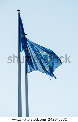 EU flags in front of the European Parliament headquarters in Strasbourg, France  - stock photo