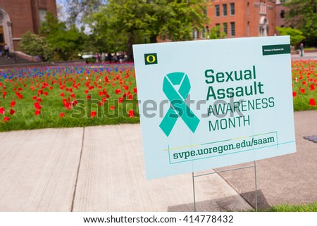 EUGENE, OR - APRIL 28, 2016: Sexual Assault Awareness Month demonstration and visual display on the lawn in front of the Lillis Business School on University of Oregon campus. - stock photo