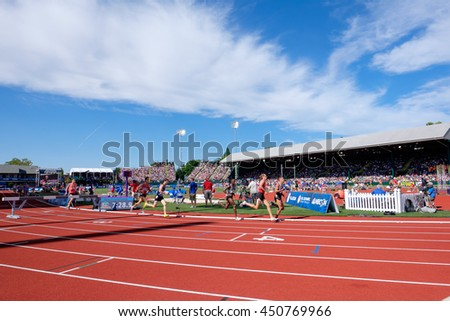 EUGENE, OR - JULY 4, 2016: Runners compete in the Men's 5000m qualifying round at the USATF Olympic Trials for track and field at Historic Hayward Field in Eugene, Oregon. - stock photo
