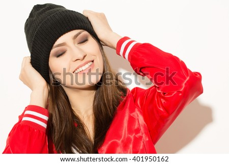 Euphoria. Happy attractive female smiling and touching her head.  - stock photo