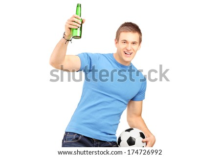Euphoric fan holding a beer bottle and football cheering isolated on white background