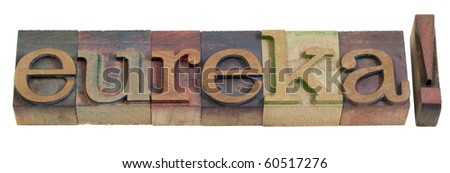 eureka - discovery or illumination concept, famous exclamation attributed to Archimedes -  vintage wooden letterpress printing blocks, stained by color inks, isolated on white - stock photo