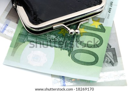 euro and a leather purse isolated on white - stock photo