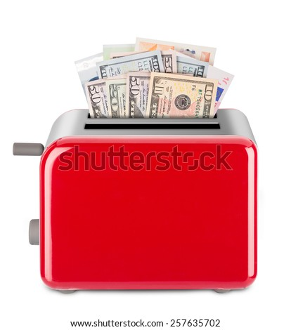 Euro and Dollar bills in a toaster. Isolated on white background. - stock photo