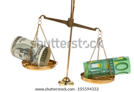 euro-and dollar bills in front of white background on a scale