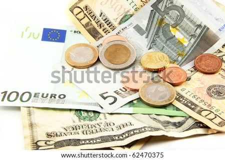 Euro and dollar bills with coins isolated on white - stock photo