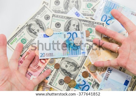 Euro and dollars in greedy hands of a man. Power and succes. - stock photo