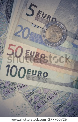 euro and polish zloty banknotes. international currency