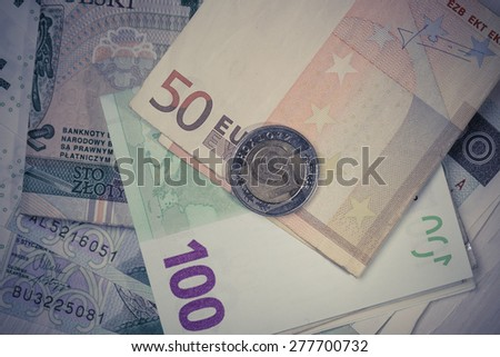 euro and polish zloty banknotes. international currency - stock photo