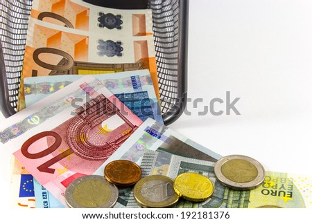 Euro banknote in metal basket, white background